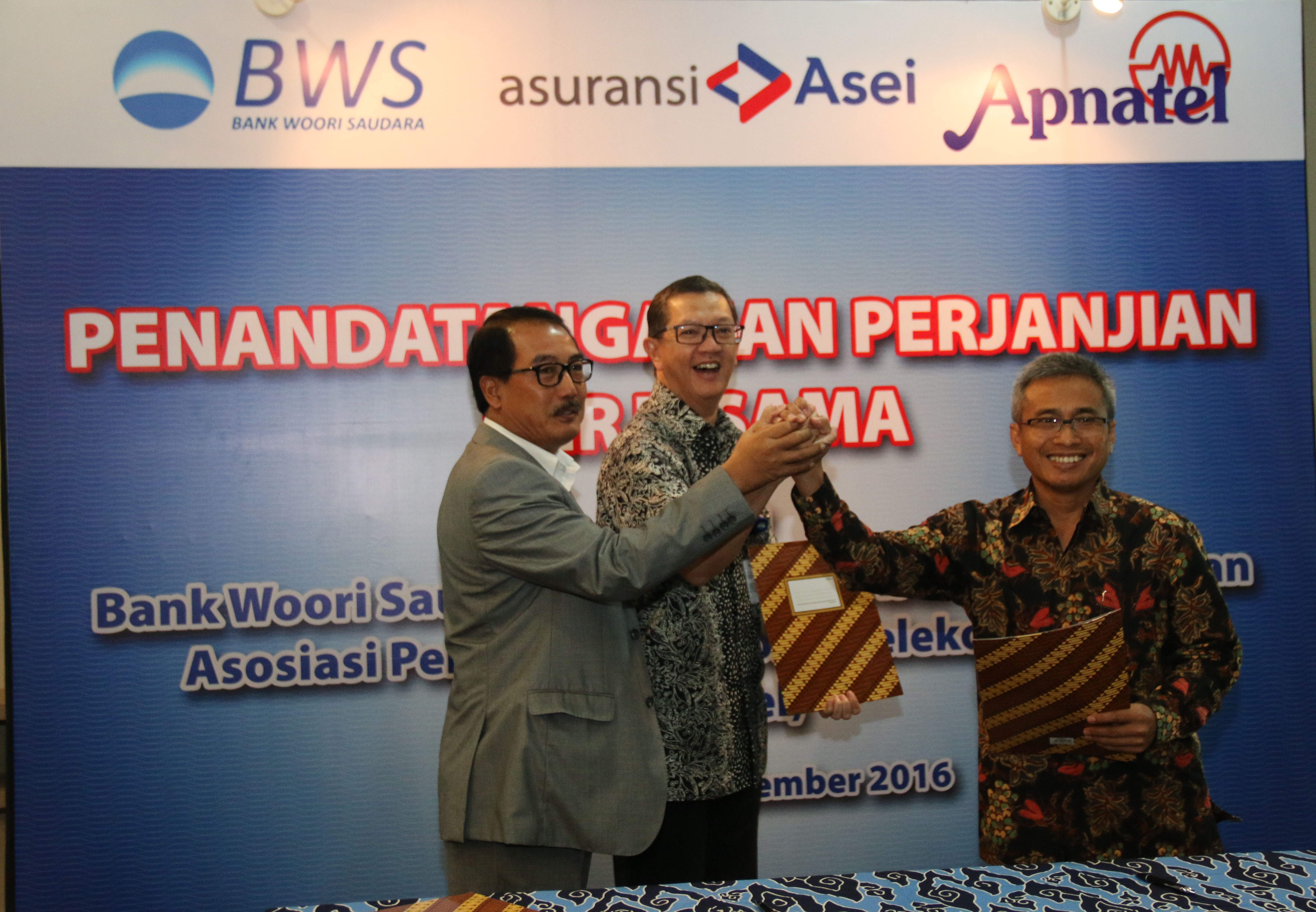 Penandatanganan Perjanjian Kerjasama Antara Asuransi Asei, Bank Woori Saudara & APNATEL