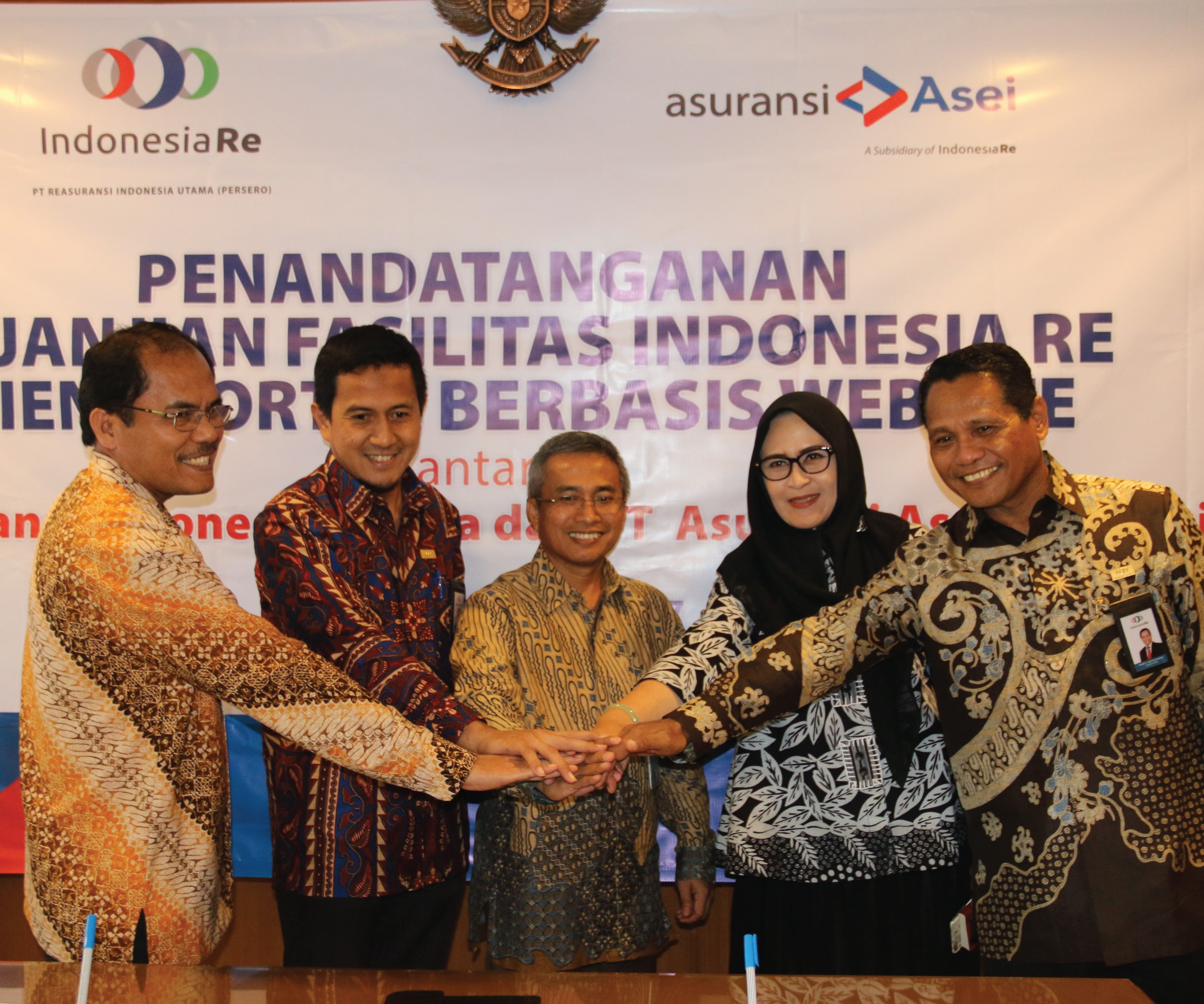 The Signing of Indonesia Re Client Web-Based Portal Facility Agreement